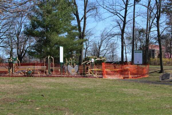 Fencing keeps children away from a playground in Waveny Park in New Canaan on Friday, March 27, 2020, as an attempt to slow the spread of the coronavirus.