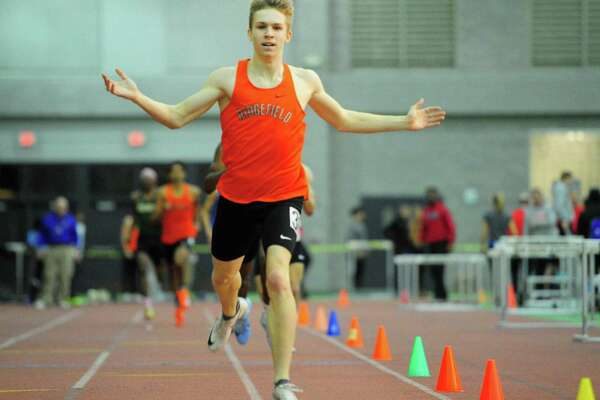 Ridgefield's Simon Jupp crosses the finish in the 600 meter race during CIAC Class LL Track Championship action in New Haven on Thursday Feb. 13.