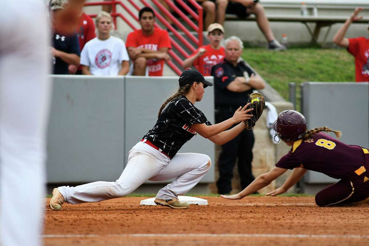 Katy junior third baseman Kat Lopez, left, puts a late tag on Deer Park baserunner Jasie Roberts on a close play at third base in the top of the 6th inning of game two of their Class 6A Region III final series at Cougar Softball Stadium on the campus of the University of Houston on Friday, May 26, 2017. (Photo by Jerry Baker/Freelance)