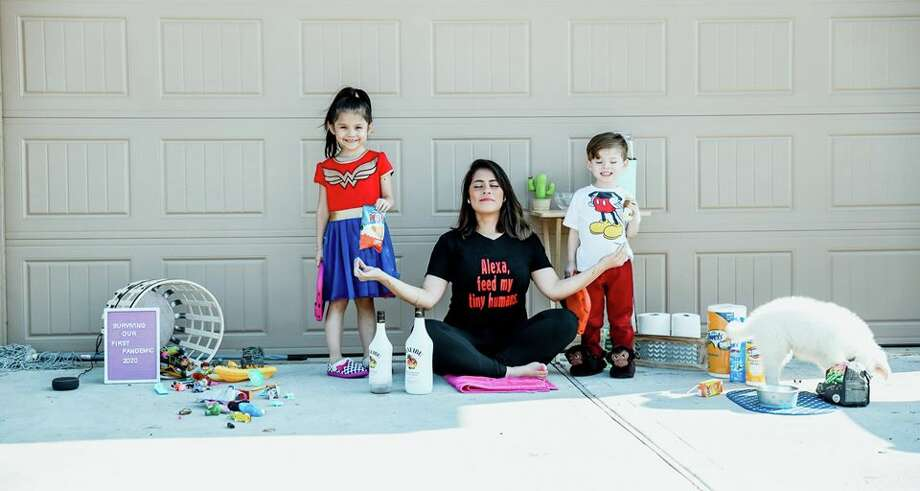 """Houston-based photographer Yuli Vargas came up with the idea of a creative neighborhood photo shoot. She captured how her neighbors were surviving """"Pandemic 2020"""" and staying safe. Photo: Yuli Vargas"""
