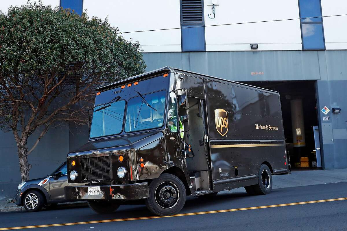 A truck departs from the UPS facility on San Bruno Avenue in San Francisco, Calif., on Thursday, March 26, 2020.
