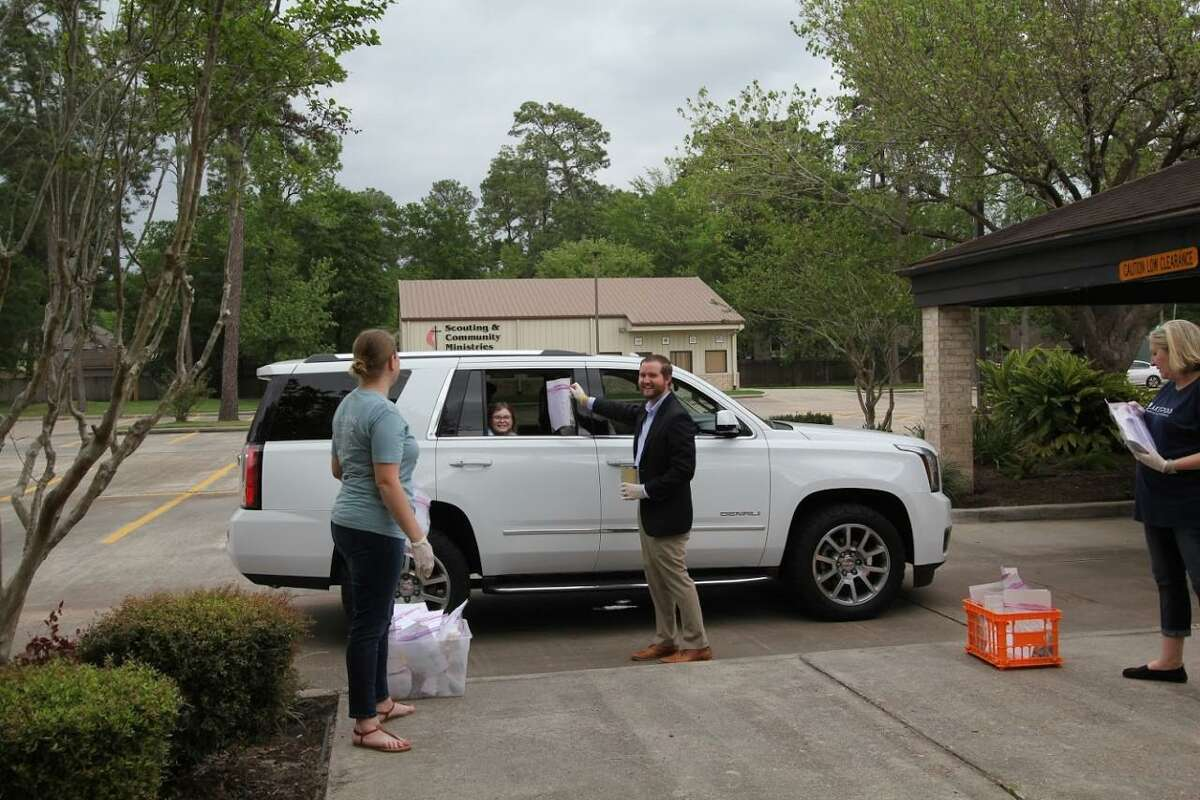 Children's Ministries gives out Science Kits through a drive through with Pastor Shuler Sitsch at Lakewood United Methodist Church in northwest Houston.