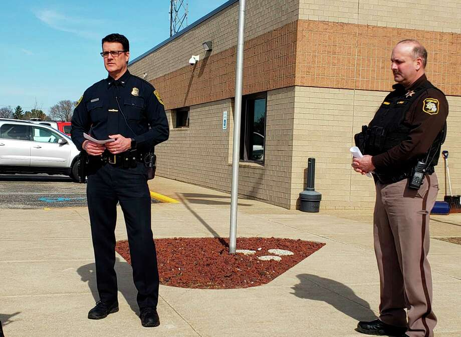 """Tim Kozal, Manistee public safety director (left) and Ken Falk, Manistee County sheriff, address recent concerns about an influx of calls from residents reporting others for violating the recent """"Stay Home, Stay Safe"""" executive orders from Michigan's governor surrounding COVID-19. (Arielle Breen/News Advocate)"""