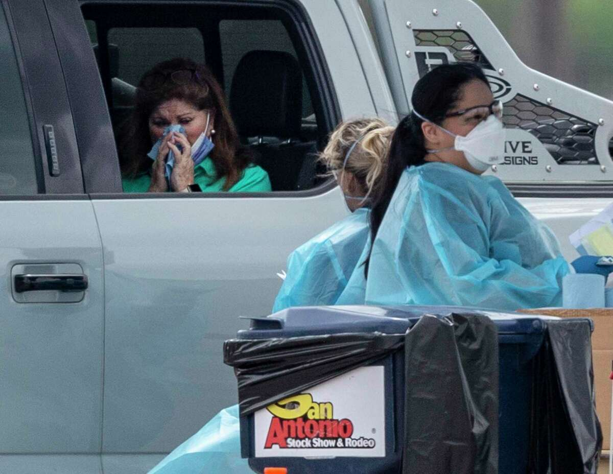 A person is tested for the coronavirus on March 18 at a drive-up facility in Bexar County. The City of San Antonio, Bexar County and the South Texas Regional Advisory Council opened a testing center at Freeman Coliseum.