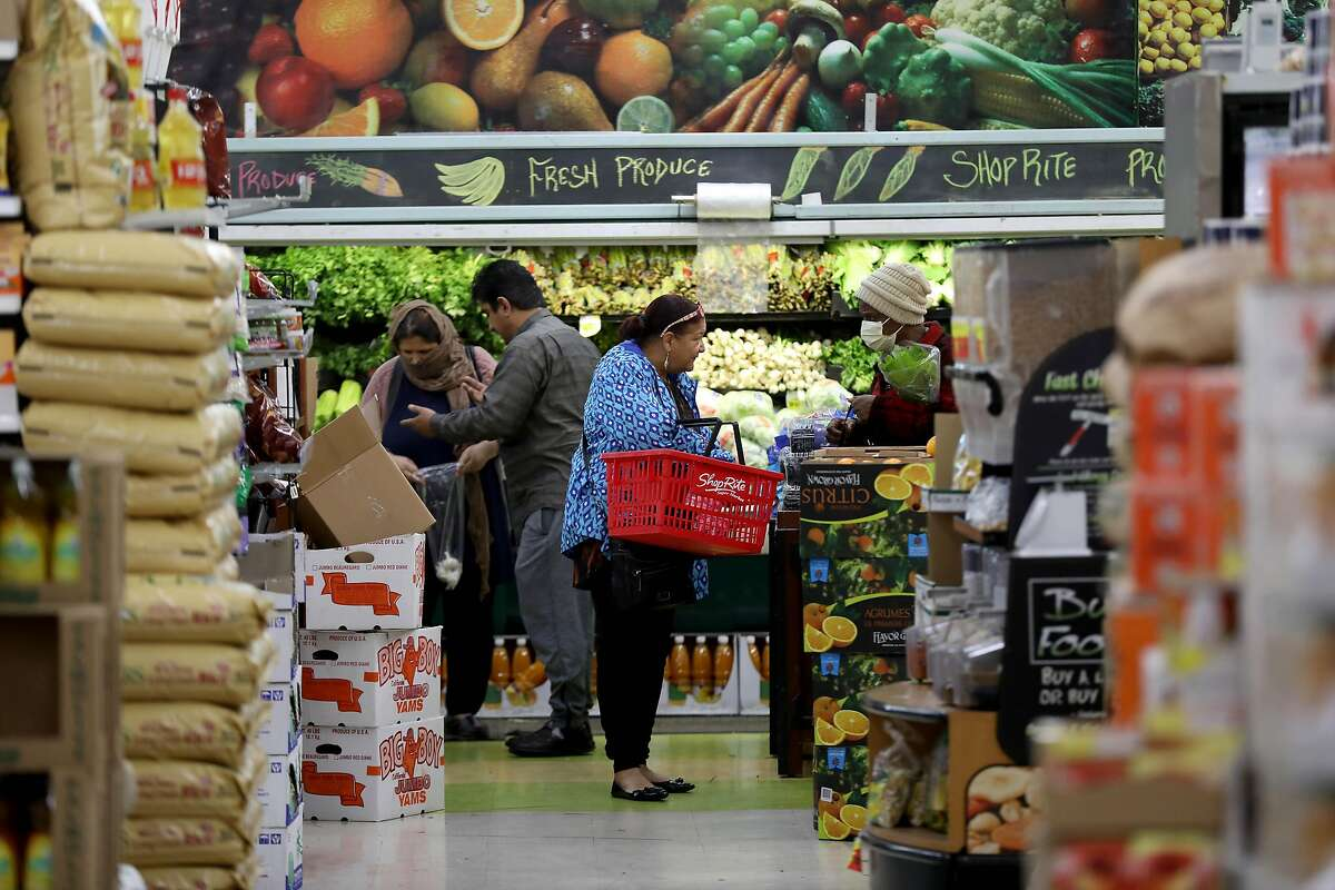 Customers shop inside Shop Rite, located at 5800 Bancroft Ave., on Thursday, March 26, 2020, in Oakland, Calif.