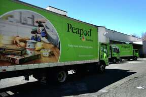 Peapod trucks get loaded up with grocieries from Super Stop and Shop Friday, March 27, 2020, in Norwalk, Conn. Residents in need of groceries are relying heavily on Peapod delivery service while others brave interaction by viviting the two locations in Main and Connecticut Avenues.