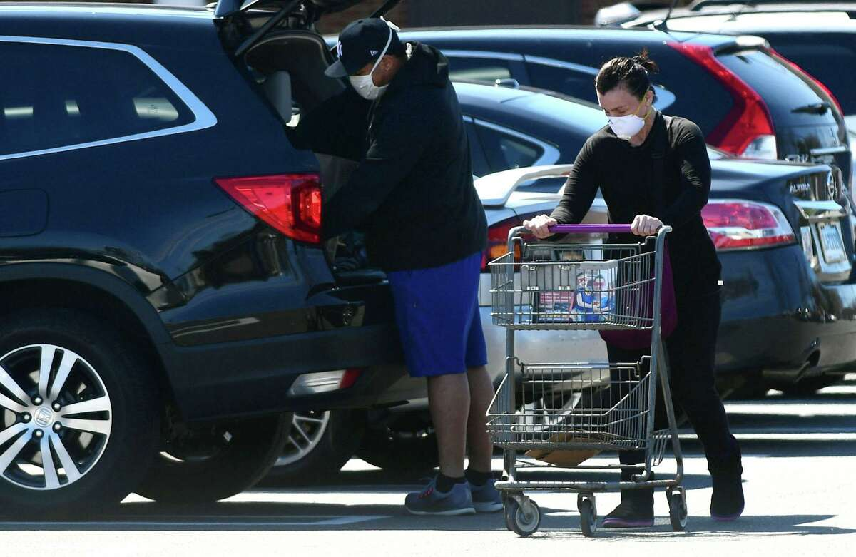 Shoppers get grocieries from Super Stop and Shop Friday, March 27, 2020, in Norwalk, Conn. Residents in need of groceries are relying heavily on Peapod delivery service while others brave interaction by viviting the two locations in Main and Connecticut Avenues.