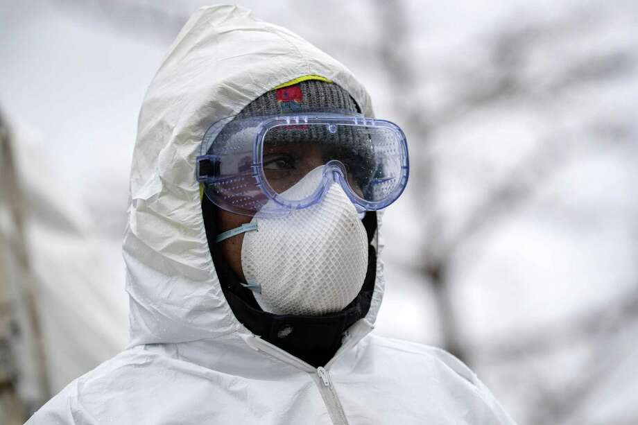 STAMFORD, CT - MARCH 23: A health worker dressed in personal protective equipment (PPE) awaits new patients at a drive-thru coronavirus testing station at Cummings Park on March 23, 2020 in Stamford, Connecticut. Availability of protective clothing for medical workers has become a major issue as COVID-19 cases surge throughout the United States. (Photo by John Moore/Getty Images) Photo: John Moore / Getty Images / 2020 Getty Images