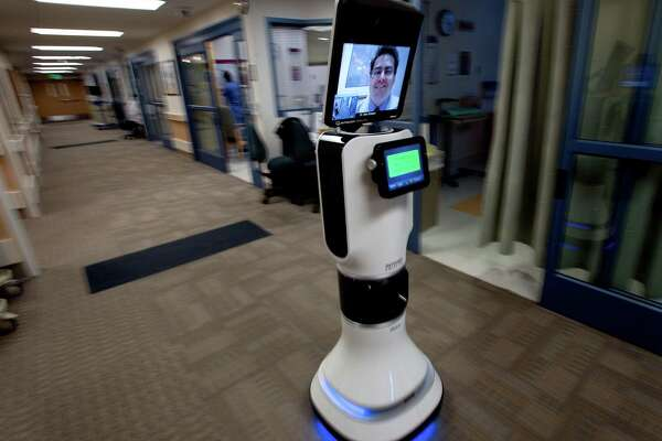 A doctor provides telehealth visits at a hospital in California.