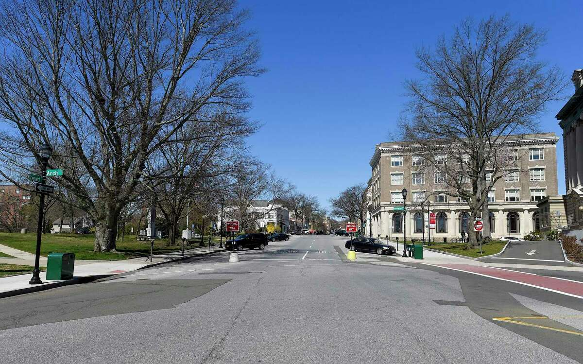 A view looking up Greenwich Avenue on March 27. Normally a Greenwich Police Officer would be directing the often very busy and crowded roadway while handling pedestrians crossing the Avenue, however as many businesses are closed, residents are sheltering and not shopping the stores in response to the COVID-19 crisis.