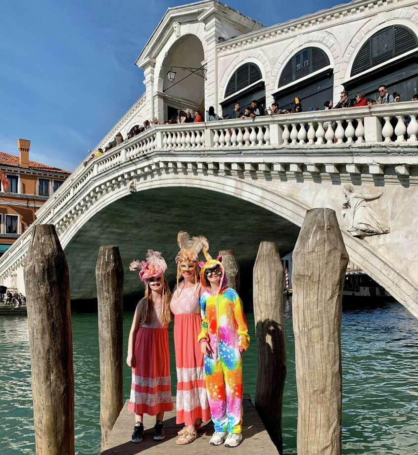 MegZugelder and her kidsat Carnevale in Venice the week before the coronavirus measures began taking place. Photo: Courtesy Of MegZugelder / Courtesy Of MegZugelder