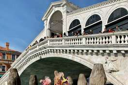 Meg Zugelder and her kids at Carnevale in Venice the week before the coronavirus measures began taking place.