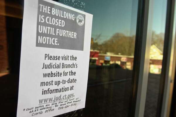Danbury Superior Courthouse, was closed Wednesday after an employee in the clerk's office tested positive for the coronavirus. Thursday, March 26, 2020, in Danbury, Conn.