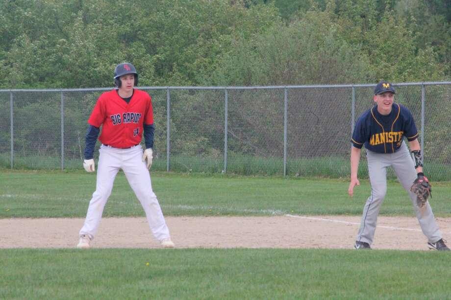 Big Rapids' Keaton Ballard (14) gets a lead off first base in action last season. (Pioneer file photo)