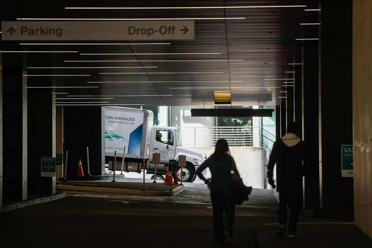 People walk into the California Pacific Medical Center using a side entrance in San Francisco, California, on Wednesday, March 6, 2019.