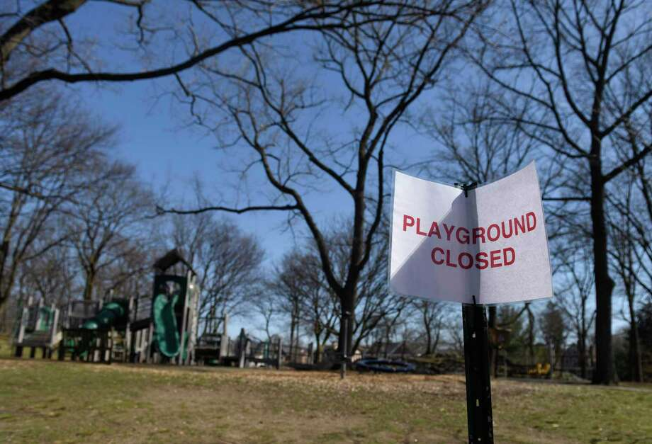 A closed sign is displayed at the Bruce Park playground in Greenwich, Conn. Wednesday, March 18, 2020. Photo: Tyler Sizemore / Hearst Connecticut Media / Greenwich Time