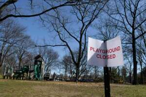 A closed sign is displayed at the Bruce Park playground in Greenwich, Conn. Wednesday, March 18, 2020. Greenwich parks are still open, but playgrounds are closed to protect against the spread of the coronavirus.