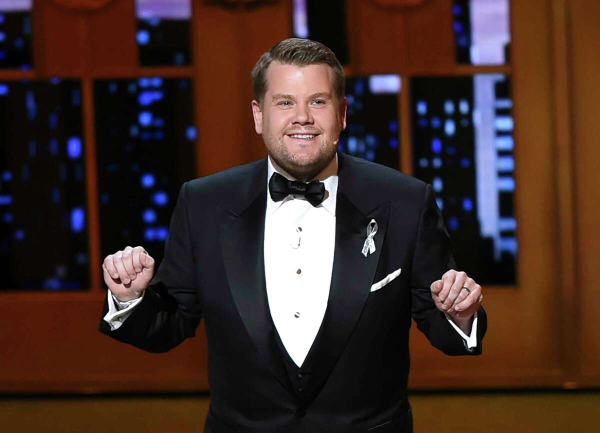 FILE - This June 12, 2016 file photo shows James Corden hosting the Tony Awards in New York. Corden is returning to host the 73rd annual Tony Awards. The American Theatre Wing on Tuesday, March 19, 2019, announced the host of CBSa€™ a€œThe Late Late Showa€ will preside over Broadwaya€™s biggest night which honors the seasona€™s best plays and musicals. (Photo by Evan Agostini/Invision/AP, File)