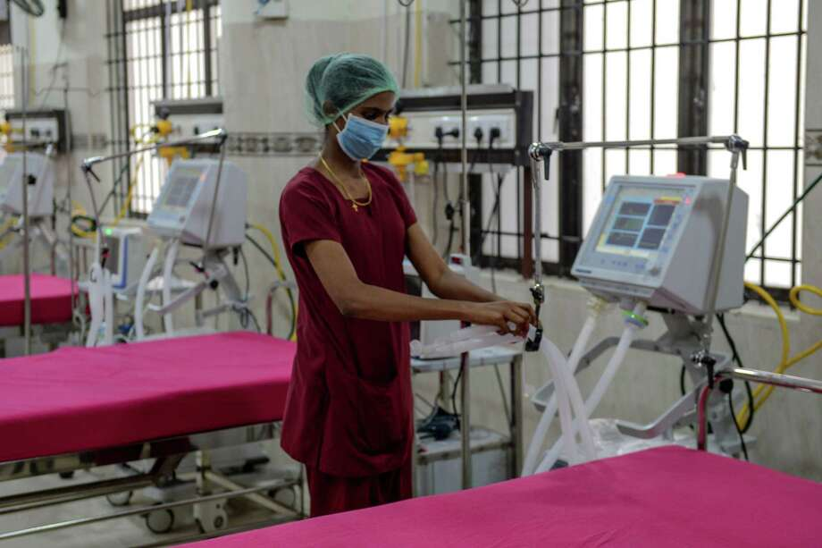 A medical staff checks on a ventilator of an intensive care unit at a newly inaugurated hospital by the Tamil Nadu state during a government-imposed nationwide lockdown as a preventive measure against the COVID-19 coronavirus, in Chennai on March 27, 2020. (Photo by Arun SANKAR / AFP) (Photo by ARUN SANKAR/AFP via Getty Images) Photo: ARUN SANKAR, Contributor / AFP Via Getty Images / AFP or licensors