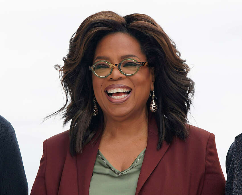 FILE - This March 25, 2019 file photo shows Oprah Winfrey during an event to announce new Apple products in Cupertino, Calif. Winfrey says shea€™s playing it safe when it comes to the rapidly spreading coronavirus. The 66-year-old entertainment icon said that she has been quarantining and practicing social distancing at her home. Winfrey has been busy working despite being stuck at home. She interviewed actor Idris Elba, who tested positive for the coronavirus, through FaceTime for an episode of