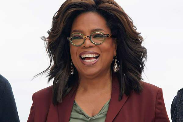 """FILE - This March 25, 2019 file photo shows Oprah Winfrey during an event to announce new Apple products in Cupertino, Calif. Winfrey says shea€™s playing it safe when it comes to the rapidly spreading coronavirus. The 66-year-old entertainment icon said that she has been quarantining and practicing social distancing at her home. Winfrey has been busy working despite being stuck at home. She interviewed actor Idris Elba, who tested positive for the coronavirus, through FaceTime for an episode of """"Oprah Talks: COVID-19"""" on Apple TV. (AP Photo/Tony Avelar, File)"""