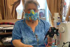 Cindy Wolfe and a team of local seamstresses are working to create masks for local caregivers amid the shortage caused by ongoing demand amid the COVID-19 pandemic.
