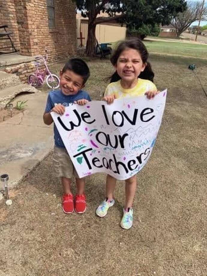 Kids of all grade levels line teacher parade route in Abernathy as AISD teachers pass by to catch a glimpse and say hi to their students. Photo: Courtesy Photos/Jenci Chambers