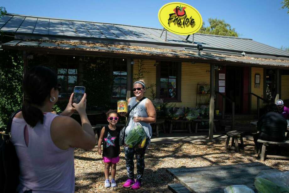 Martha Goodlow and her 5-year-old daughter Ava Goodlow pose outside of Fralo's in San Antonio after shopping for groceries there on March 25, 2020. Former Spurs player Tpny Parker was seen recently supporting  the pizza restaurant during the coronavirus stay-at-home orders. Photo: Josie Norris /Staff Photographer / **MANDATORY CREDIT FOR PHOTOG AND SAN ANTONIO EXPRESS-NEWS/NO SALES/MAGS OUT/TV
