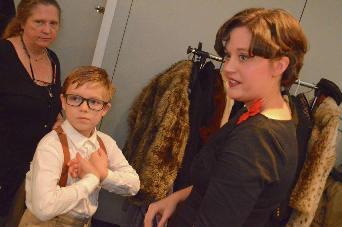 """Patrick Plomin, 9, of Fairfield, and his mom, Jillian Shaw Plomin, chat during intermission at the Clan Na Gael Players performance of """"It's a Wonderful Life"""" at the Gaelic American Club on Nov. 17, 2017, in Fairfield."""