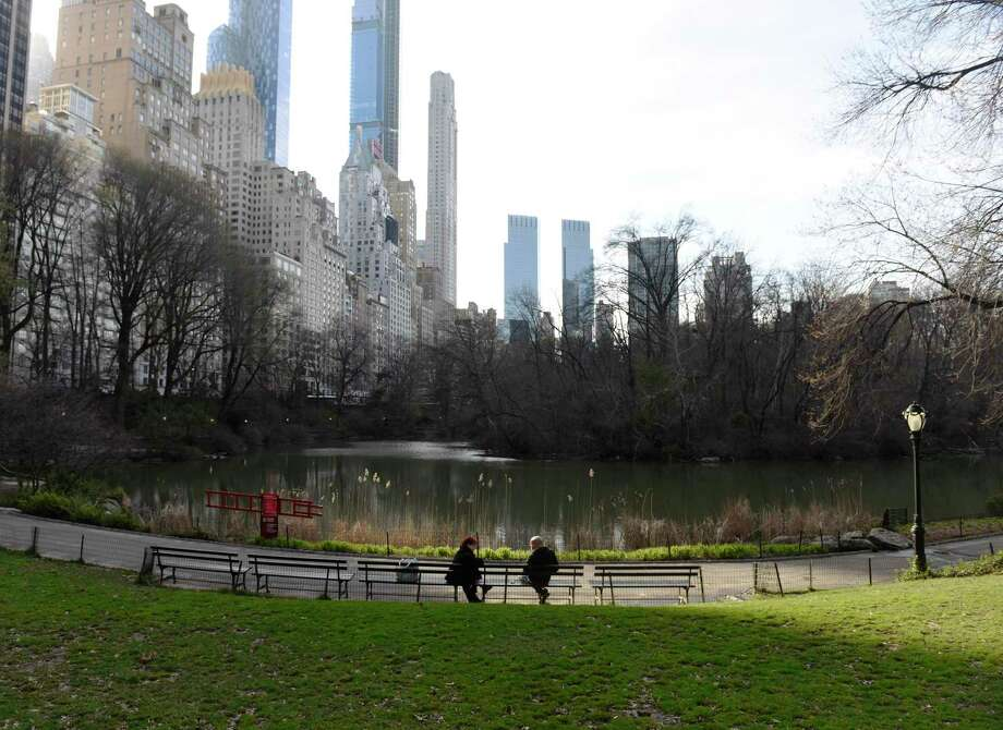 Two people sit at chat on a bench in a quiet Central Park in New York City on Thursday, March 26, 2020. New York City continues to see more new cases of the coronavirus than anywhere else in the country, and city streets have become relatively quiet with most businesses closed and Subway service limited. Photo: Tyler Sizemore / Hearst Connecticut Media / Greenwich Time