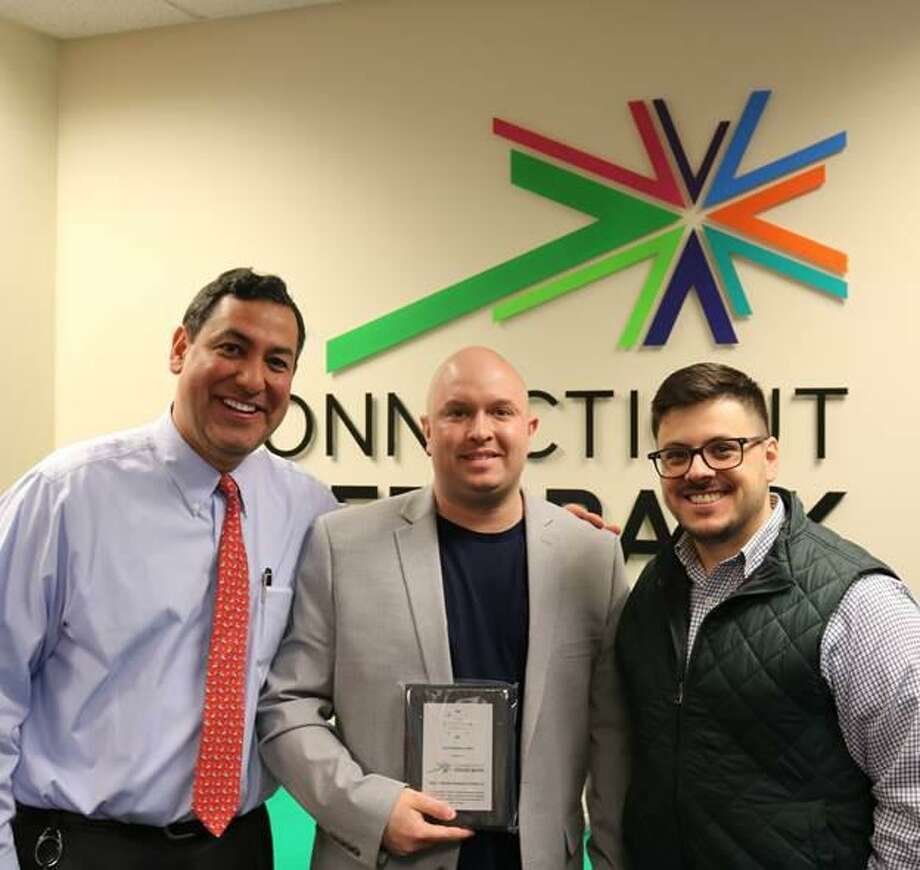 Bryan Garcia, president and CEO of the Connecticut Green Bank; Top Performer Ryan Murphy; and Joe Buonannata, Smart-E program manager. Photo: Contributed Photo
