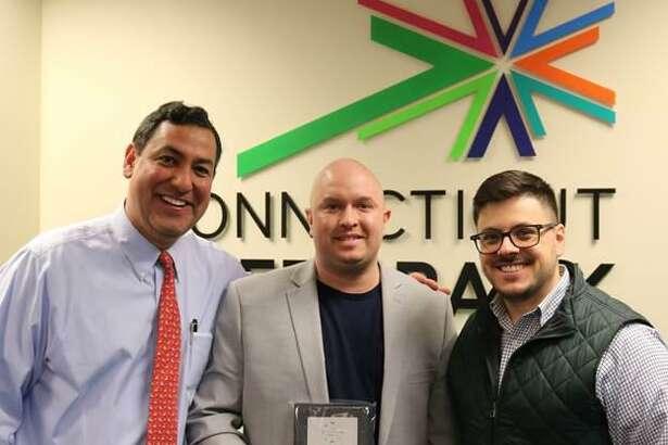 Bryan Garcia, president and CEO of the Connecticut Green Bank; Top Performer Ryan Murphy; and Joe Buonannata, Smart-E program manager.