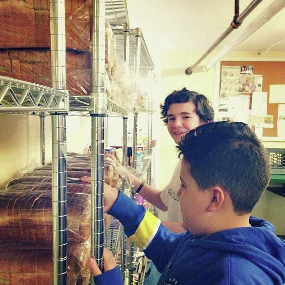 Arch Street Teen Center students volunteer at Neighbor to Neighbor, the local food pantry. Photo: Contributed / Contributed Photo / Greenwich Time