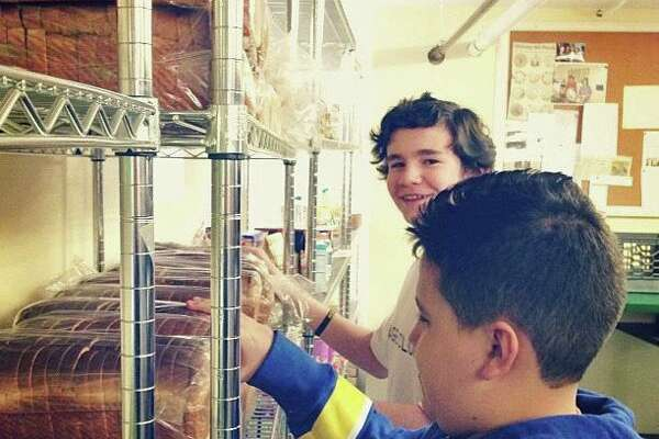 Arch Street Teen Center students volunteer at Neighbor to Neighbor, the local food pantry.