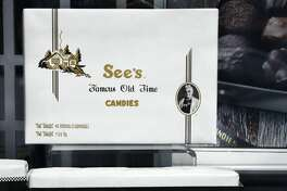 PALM SPRINGS, CALIFORNIA - FEBRUARY 28, 2019: A window display at a See's Candies shop in Palm Springs, California, includes boxes of chocolates. Founded in Los Angeles in 1921, the company is now headquartered in San Francisco. Since 1921 the company has been owned by Warren Buffett's Berkshire Hathaway Corporation. (Photo by Robert Alexander/Getty Images)