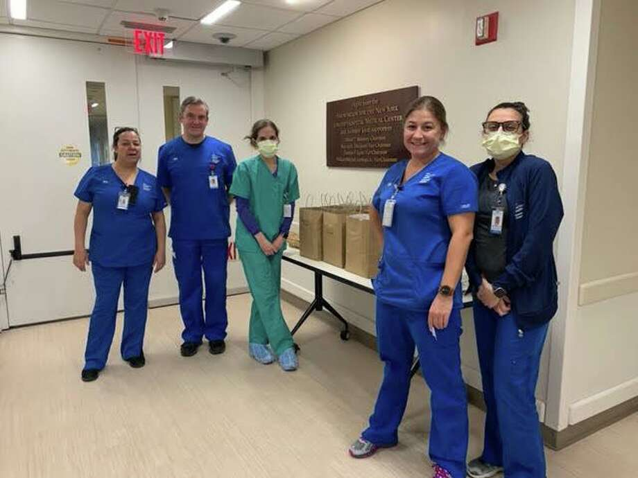 Greenwich Hospital staff with a donation. Photo: Contributed Photo /