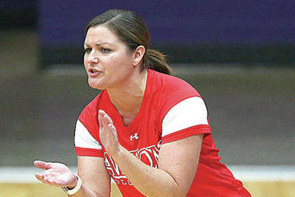 Alton's coach Stacey Ferguson, shown encouraging her Redbirds during a 2017 match at Collinsville, has accepted the job as EA-WR volleyball coach after spending the past 18 years at Alton High.