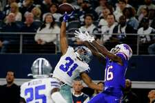 Former St. Paul and UConn star Byron Jones, seen breaking up a pass in a 2019 game against Buffalo, became the highest-paid cornerback in NFL history.