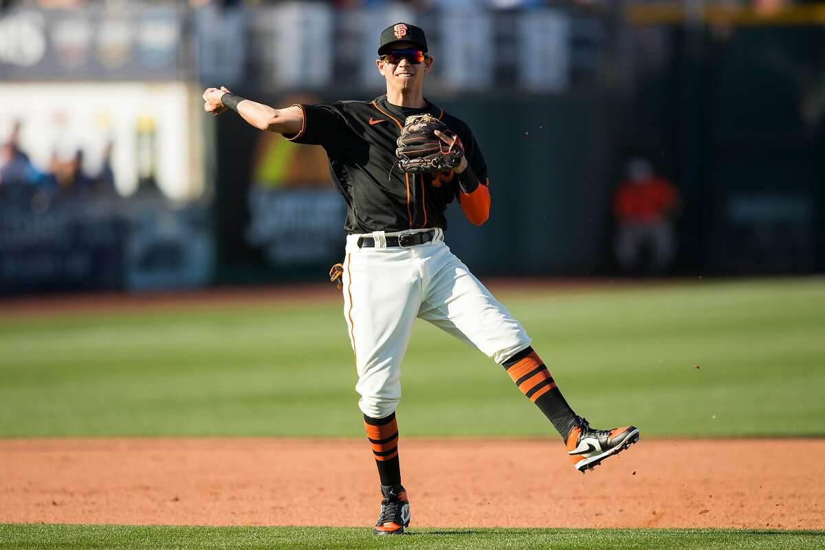 SCOTTSDALE, AZ - FEBRUARY 22: Mauricio Dubon #1 of the San Francisco Giants throws to first base during the game against the Los Angeles Dodgers on Saturday, February 22, 2020 at Scottsdale Stadium in Scottsdale, Arizona. (Photo by Adam Glanzman/MLB Photos via Getty Images)
