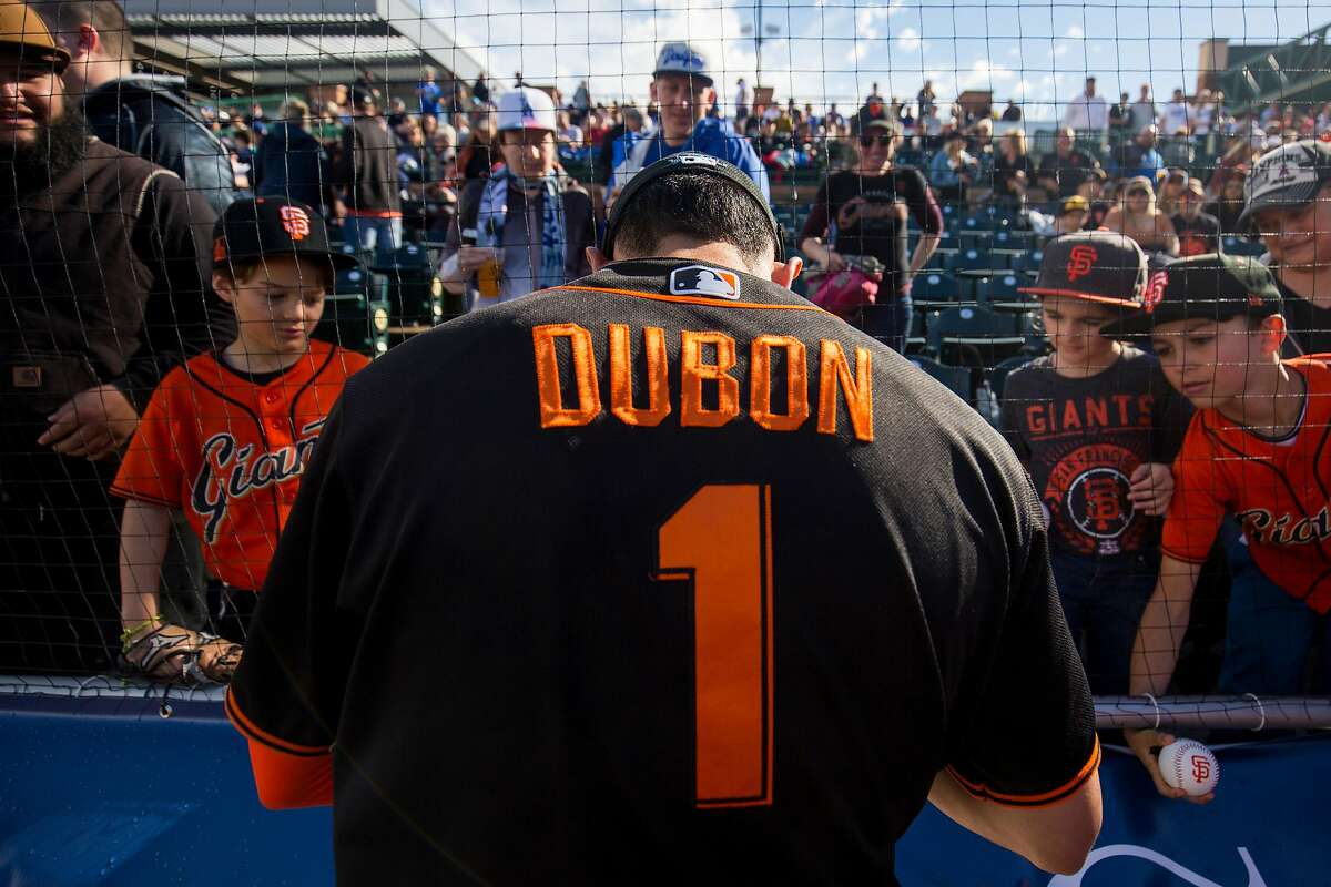 SCOTTSDALE, AZ - FEBRUARY 22: Mauricio Dubon #1 of the San Francisco Giants signs autographs before a game against the Los Angeles Dodgers on Saturday, February 22, 2020 at Scottsdale Stadium in Scottsdale, Arizona. (Photo by Adam Glanzman/MLB Photos via Getty Images)