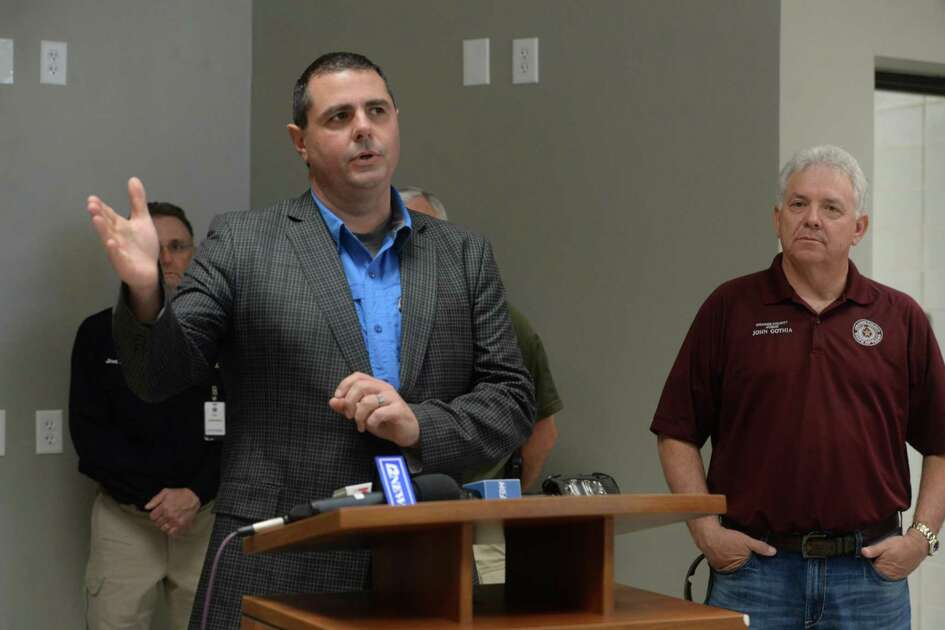 Hardin County Judge Wayne McDaniels fields questions as representatives from multiple Southeast Texas counties annnounce the opening of a drive-thru testing unit for COVID-19 at Jack Brooks Regional Airport Monday. Photo taken Monday, March 23, 2020 Kim Brent/The Enterprise
