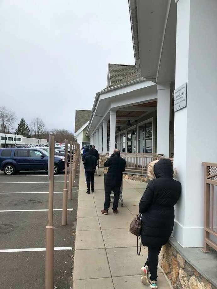 Social distancing being practiced at Whole Foods in Darien on Saturday. Photo: Jayme Stevenson