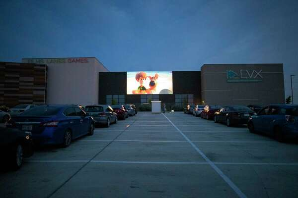 """Cars are lined up at the EVO Entertainment facility in Schertz on Friday night, March 27, 2020. The EVO Drive-In showed """"Spider-Man Homecoming,"""" free of charge, although patrons were encouraged to buy food and beverage to support employees working the show. The event provided a chance for people to see a movie while maintaining social distancing to combat the spread of the coronavirus."""