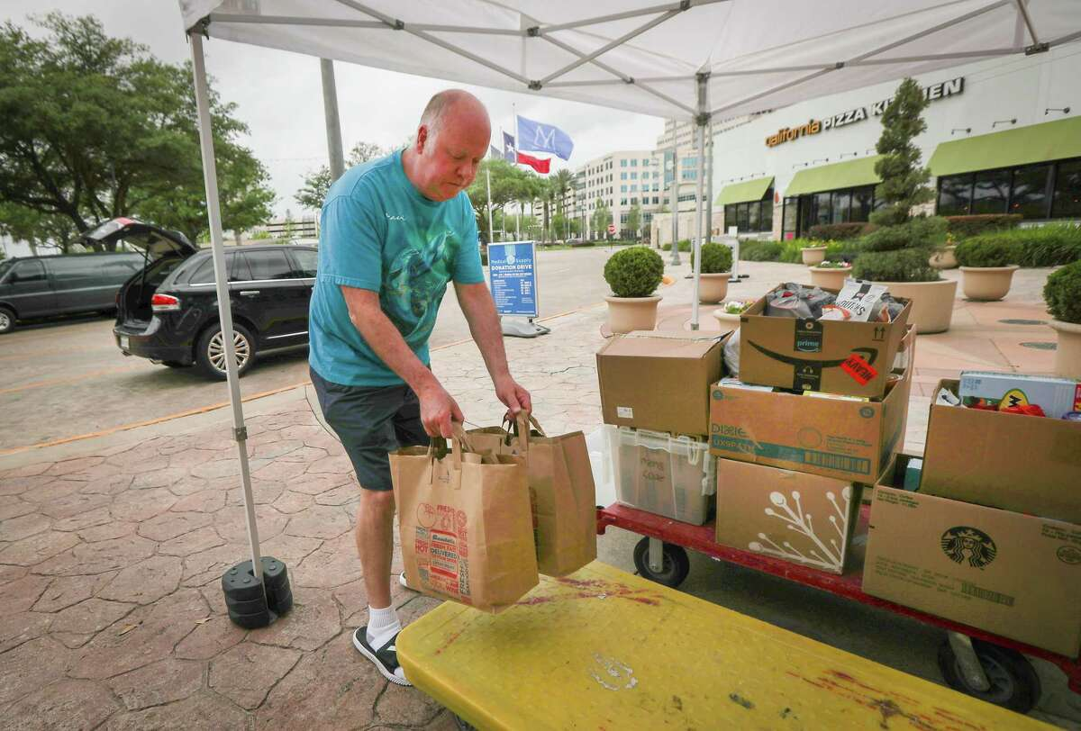 Todd Fuller donated two sack for groceries at Memorial City Mall where a vital donation drive was held Saturday, March 28, 2020, in Houston.