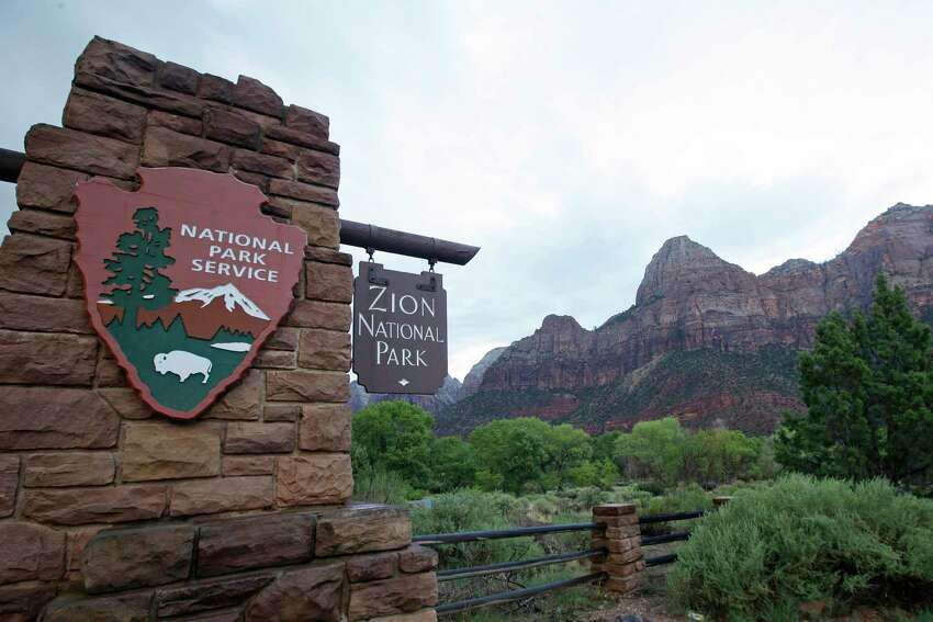 FILE - This Sept. 15, 2015, file photo, shows Zion National Park near Springdale, Utah. Zion National Park announced Monday, Marc h 23, 2020, it is closing its campgrounds and part of a popular trail called Angel's Landing that is often crowded with people. The top part of the hike that is being closed is bordered by steep drops and ascends some 1,500 feet (457 meters) above the southern Utah park's red-rock cliffs, offering sweeping views.(AP Photo/Rick Bowmer, File)
