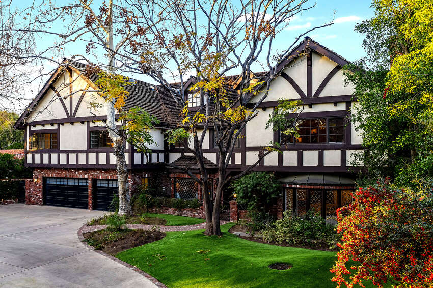 'Criminal Minds' star Joe Mantegna is asking $4.195 million for his Tudor-style home in Los Angeles' Toluca Lake neighborhood. Owned by the actor for nearly three decades, the two-story house features exposed brickwork, half-timbering and leaded glass windows. A great room with beamed ceilings holds a pub-style bar, billiards area and screening room. (Adrian Van Anz/TNS)