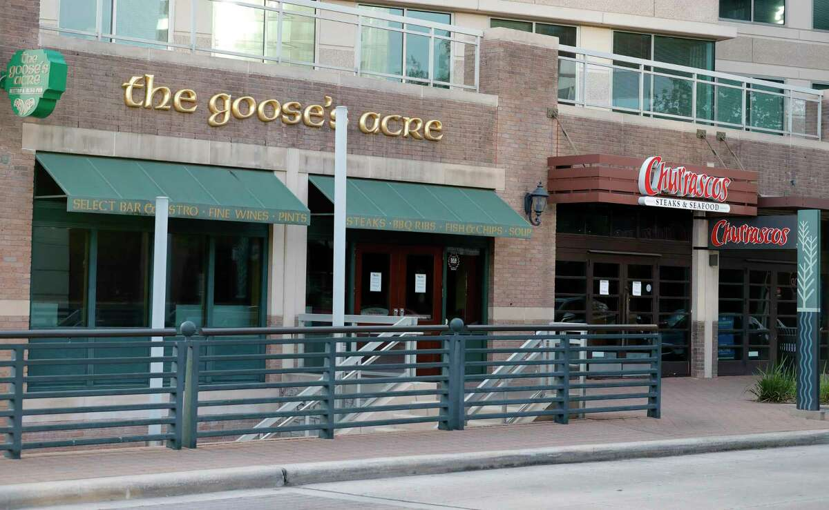 The Goose's Acre and Churrascos restaurants are seen vacant along The Woodlands Waterway Square in The Woodlands. In less than 24 hours, Montgomery County total cases of the new coronavirus jumped 54 percent to 63 according to public health officials.