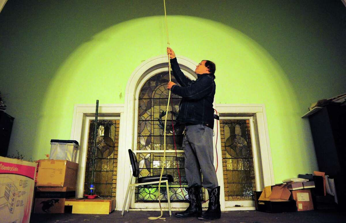 Fred Picroski rings the bells at 8 p.m. at Second Congregational Church in Derby, Conn..