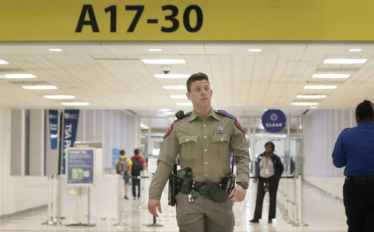 A Texas DPS trooper walks through Terminal A on Saturday, March 28, 2020, at Bush Intercontinental Airport in Houston. Texas Governor Greg Abbott issued an executive order mandating a two-week self-quarantine for anyone traveling to Texas from the tri-state area of New York, New Jersey and Connecticut, as well as the city of New Orleans, with Texas being their final destination. DPS is tasked with enforcing the order, and troopers were stationed at airports throughout the state to screen passengers arriving from those locations, starting at noon, Saturday, March 28, 2020.