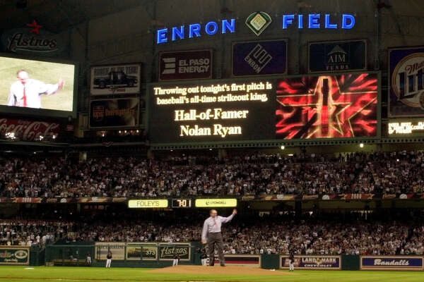 FILE--Nolan Ryan acknowledges the crowd before throwing out the first ceremonial pitch at the new Enron Field before the inaugural exhibition game between the Houston Astros and New York Yankees in this March 30, 2000 photo, in Houston. The team wants the bankruptcy court to force Enron to make a decision on whether to honor the 30-year, $100 million naming rights agreement signed in 1999.